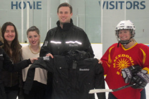 Rob Carrick awarding the MVP Player  - A  Hockley Valley Brewing Company Stormtech Winter Coat